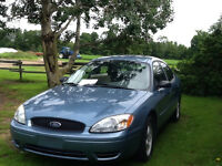 2006 blue Ford Taurus
