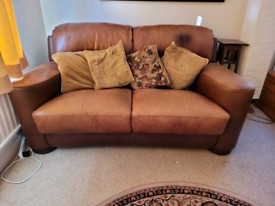 DISTRESSED TAN LEATHER 2 SEATER SOFA