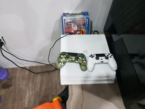Playstation 4 Pro with 2 controllers and 8 games