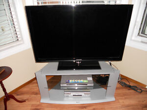 """46"""" Samsung TV, Sony DVD Player, and a Entertainment Console"""