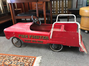 Antique pedal car fire truck fighters