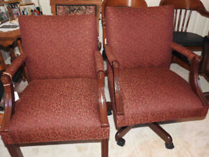 pair of vintage office chairs with new burgundy fabric