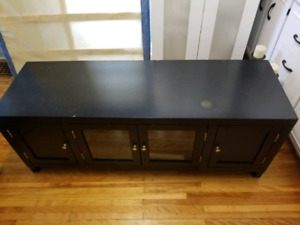 T.V. stand - solid wood - with glass doors - black
