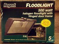 Halogen Flood Light with hinged door frame.  Still in box