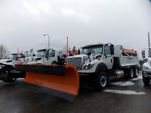 Pair of Similar Snowplows ready to work