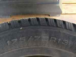 "13"" Goodyear Ultragrip studded winter tires on rims."