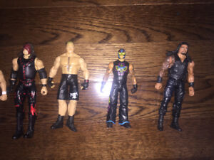 WWE action figures (x8) plus ring