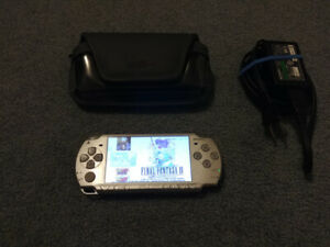 PSP Slim with hundreds of games and 32GB memory card etc
