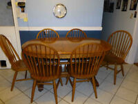 Solid Oak table with 3 leaves and 6 matching chairs $595 obo