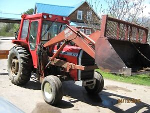 MF 270 farm tractor heated cab and loader