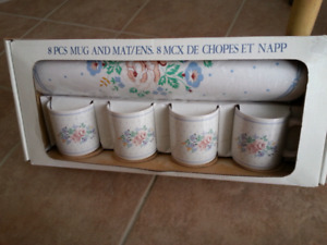 Mugs with matching placemats brand new?(((