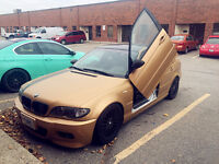 2003 bmw 330 with lambo door 5600$ only include tax
