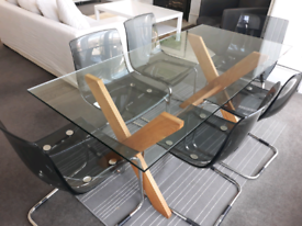 Stylish Glass top Dining table and 6 chairs