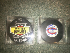 Hockey pucks autographed