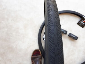 Bicycle tires and tubes for sale.