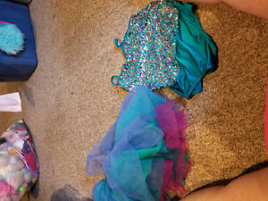 Several competition dance outfits