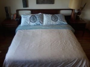 Queen size bed frame and mistress with matching side tables.