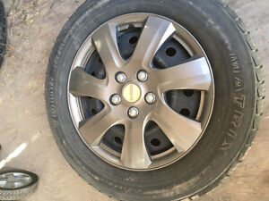 Set (4) all season tires on rims, missing  one hubcap