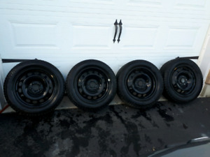 Continental Snow Tires and Rims off VW Rabbit