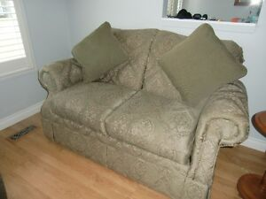 A Lazyboy love seat with matching throw pillows