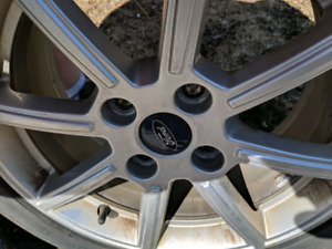 4 bolt Ford rims. With brand new tires! Looking to get 450