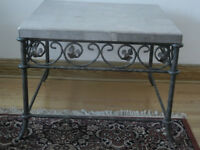 Wrought iron and topped marble coffee table.