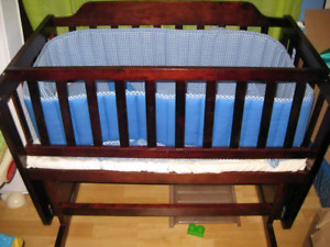 Beautiful Solid wood glider cradle that turns into a bench