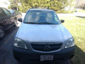 May Run 04 Mazda Tribute 4X4  $1000 OBO