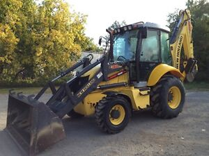 new holland B95C 2014 (900 hrs) West Island Greater Montréal image 1