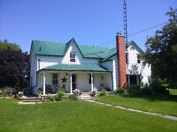 Country home with furnished room to rent.
