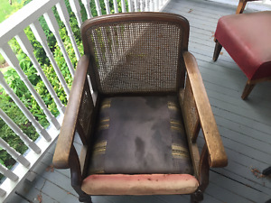 Antique cane back and sides chair