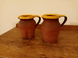 A Pair Of Vintage Handmade Clay Pitcher Jugs