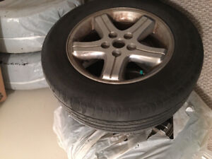 Four 225/60R16 98H  with rims