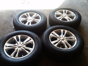 4  used alloy with BFgoodrich winter tires 245/65/17 5x114.3