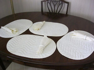 4 pc set of place mats and napkins, plus extra napkin rings