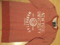 Red jumper with white writing for sale.