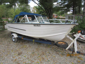 16 feet boat , motor and trailer