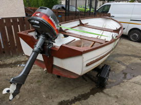 12ft boat with 4hp outboard and new trailer
