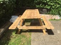 Home made pallet outside wooden bench / table