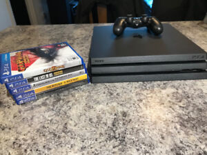 PS4 Pro with 5 Games.