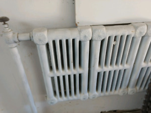 Vintage hot water radiators from historical Toronto landmark.