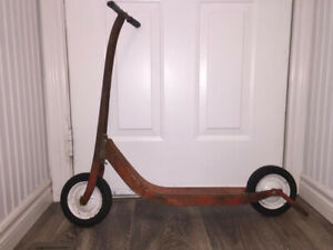 Vintage 1950s Red Metal Child's push scooter bike