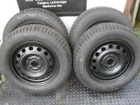 "4-185 65 r14"" Polar Trax studded winter tires on 4 bolt rims"