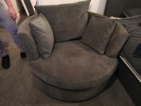 DFS grey swivel chair