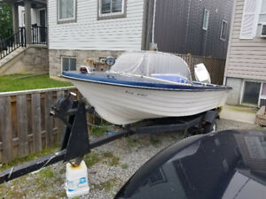 14 foot fiberglass boat with tilt trailer and 60 hp Johnson outb