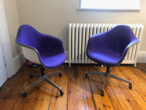 2 original Herman Miller Eames shell chairs with casters