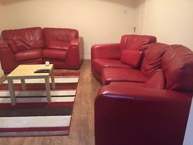 Red 2 piece Leather Sofa