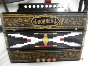 Hohner 4 bass key in C 1965-1975 Black with Gold Trim