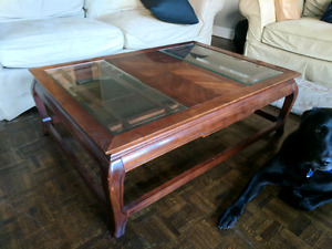 Large solid wood coffee table with glass inlay