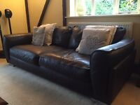 2 x Dark brown leather sofas with footstool